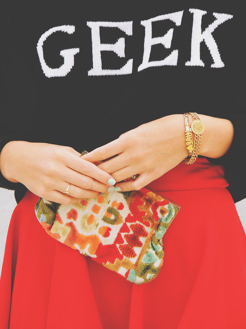 Graphic geek sweater with red midi skirt