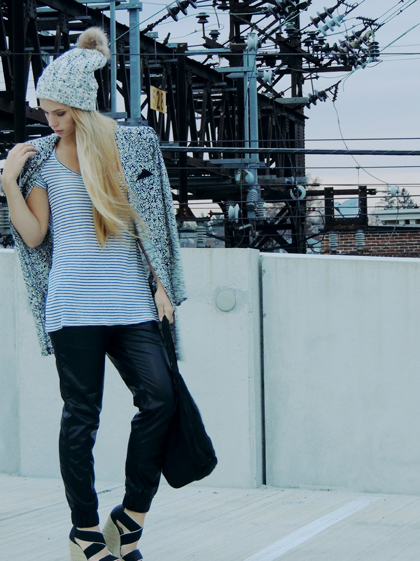 Mixing patterns and textures with leather pants and striped top