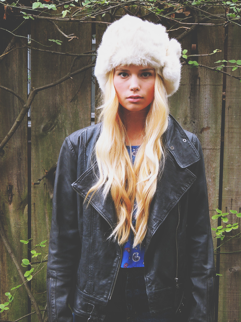 Winter outfit with fur hat and leather jacket
