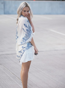 White dress and layered necklaces