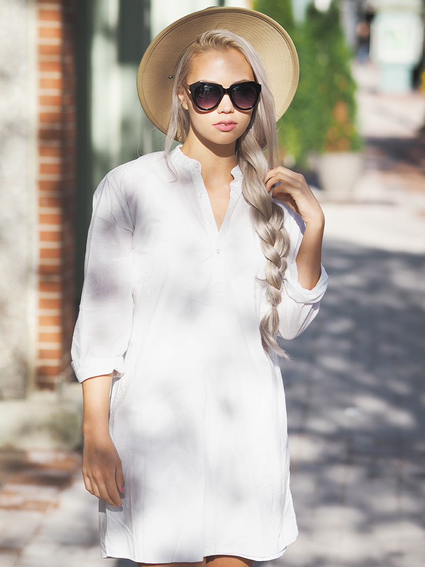 White linen dress and sunhat